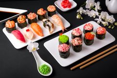 Gunkan sushi set with salmon, tuna, perch, eel, scallop, caviar, shrimp, sharp. Traditional Japanese cuisine. stock image