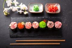 Gunkan sushi set with salmon, tuna, perch, eel, scallop, caviar, shrimp, sharp. Traditional Japanese cuisine. royalty free stock photography