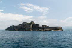 Gunkanjima (Hashima Island) in Nagasaki, Japan. Hashima Island, commonly called Gunkanjima (meaning Battleship Island), is former coal mining island. It's one of Royalty Free Stock Photography