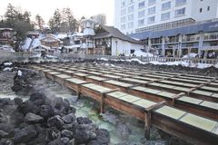 GUNMA , JAPAN. Kusatsu Onsen is one of Japan's most famous hot spring resorts and is blessed with large volumes of high quality hot spring water said to cure Royalty Free Stock Photo