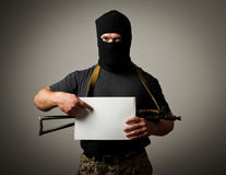 Gunman is holding white paper Stock Photos