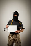 Gunman is holding white paper Stock Photo
