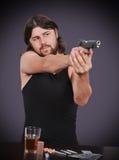 Gunman shoots from gun Royalty Free Stock Image