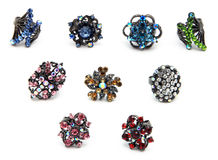 Gunmetal Rhinestine Rings. Black gunmetal with rhinestone crystal rings in a variety of colors and designs isolated on a white background Royalty Free Stock Photo