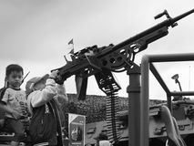 The gunner brothers. Kids acting as a gunner using a machine gun Royalty Free Stock Images
