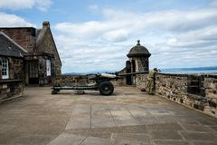 A gunner is cleaning One O`Clock gun in Edinburgh Castle Royalty Free Stock Photography