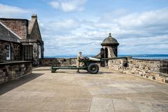 A gunner is servicing One O`Clock gun in Edinburgh Castle Royalty Free Stock Image