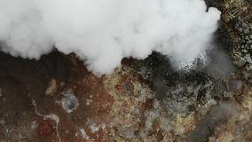 Gunnuhver hot springs and steam vents, view from above, Reykjanes peninsula, Iceland. Gunnuhver geothermal area with steam vents, hot springs and mud pools stock video
