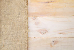 Gunny sack texture and wood  table background. Gunny sack texture and wood plank table background Stock Photos