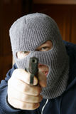 At gunpoint. Masked intruder hold YOU at gunpoint Royalty Free Stock Photo