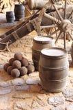 Gunpowder barrels. With stone cannonballs Stock Image