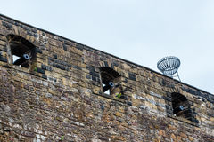 Gunpowder canons in portholes at castle wall Stock Photos