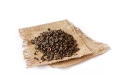 Gunpowder on canvas. Pile of green tea gunpowder on canvas royalty free stock images