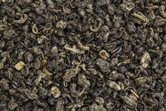 Gunpowder green tea. Background texture of loose leaf Chinese gunpowder (pearl) green tea Royalty Free Stock Image