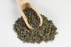 Gunpowder green tea in scoop. On a white background stock images