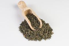 Gunpowder green tea in scoop. On a white background royalty free stock photos