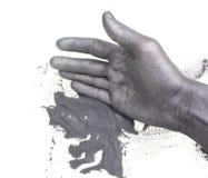 Gunpowder and hand Stock Images