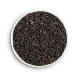 Gunpowder tea. China gunpowder tea leaves in a white bowl stock images