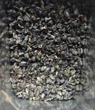 Gunpowder Chinese Tea. Gunpowder tea literally called `pearl tea` stored in a metal box with shiny sides royalty free stock image