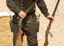 Guns 1. Gun inspection after shooting in a cowboy action shooting competition in Arizona Stock Image