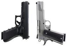 Guns. Two modern day pistols isolated on a white background Stock Image