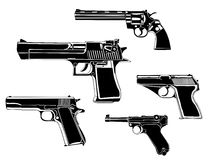Guns. Several guns, old and modern, in the Stock Images