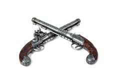 Guns. Two old-fashioned guns on white background Royalty Free Stock Photography