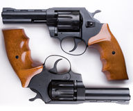 Guns. Two revolvers are on a white background Royalty Free Stock Photos