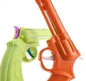 Guns. Two plastic guns on white Royalty Free Stock Photos