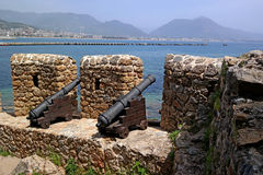 Guns Alanya Castle defended the city from enemies. Guns of the wall of the fortress of Alanya, firing at enemy ships Royalty Free Stock Image