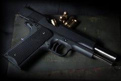Guns and ammunition. On grunge background Royalty Free Stock Photo