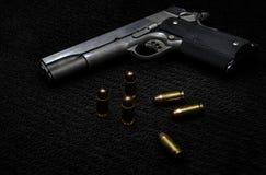 Black gun and ammunition. royalty free stock photo