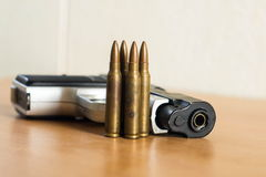 Guns and ammunition. Placed side by side on the table. Closedup Stock Images