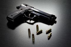 Guns and ammunition. On table Royalty Free Stock Photography