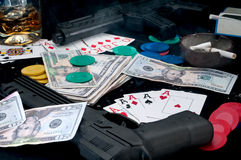 Guns and cards on a table - gambling royalty free stock photography