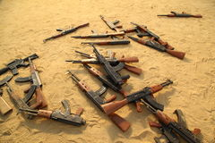 Guns in the Desert sand Royalty Free Stock Photography