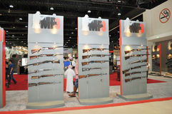 Guns display in MP3 pavilion at Abu Dhabi International Hunting and Equestrian Exhibition 2013 Royalty Free Stock Photo