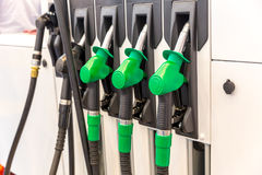 Guns at the gas station closeup, nobody. Car refuel. Unsigned fuel pistols Stock Photo