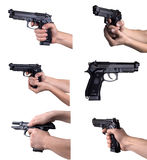 Guns in hands Royalty Free Stock Photos