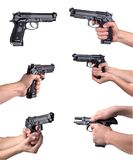 Guns in hands Royalty Free Stock Photography