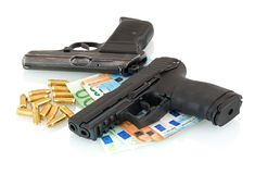 Guns, money, bullets isolated on white background with shadow reflection. Royalty Free Stock Photos