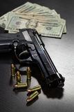 Guns and money Stock Photos