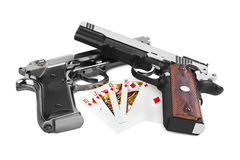 Guns and playing cards Royalty Free Stock Image