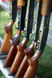 Guns in a row. Guns sitting in the gun rack at a trap shoot Royalty Free Stock Photo