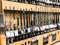 Guns for sale. South Plainfield, NJ, 02/17/2018: Hunting rifles stand on a shelf in a Dick`s Sporting Goods store Royalty Free Stock Photo