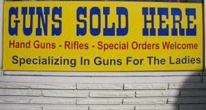 Guns sold here royalty free stock photography