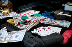 Guns and splattered blood on a card game Royalty Free Stock Photos