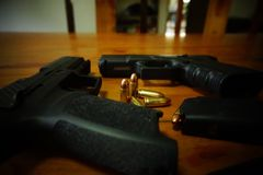 Guns hand bullet shadow royalty free stock images