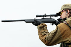 Gunshot. Shot of a soldier holding gun. Uniform conforms to special services Royalty Free Stock Photography