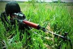 Gunshot. Shot of a soldier holding gun at a battlefield Royalty Free Stock Images